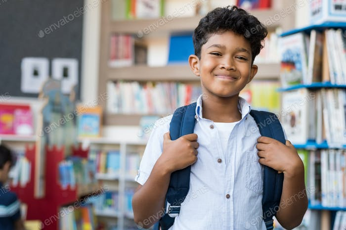 Smiling hispanic boy at school