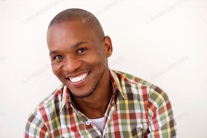 cheerful young black man smiling against white background