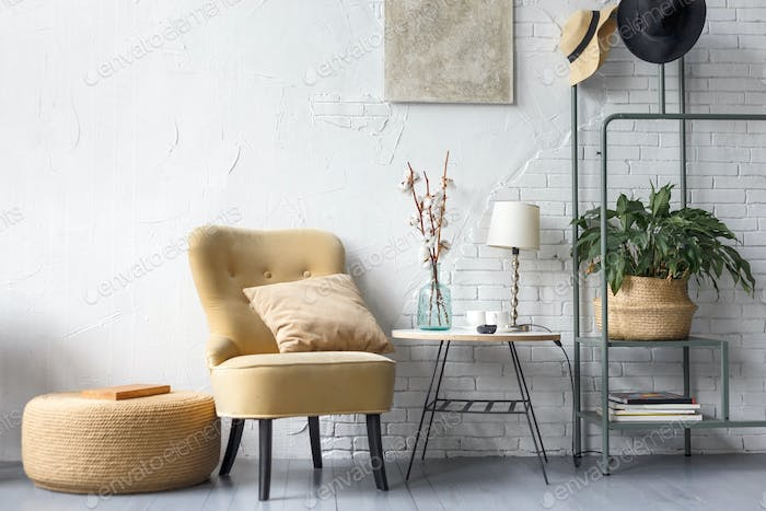 Apartment with modern armchairs and cyan wall
