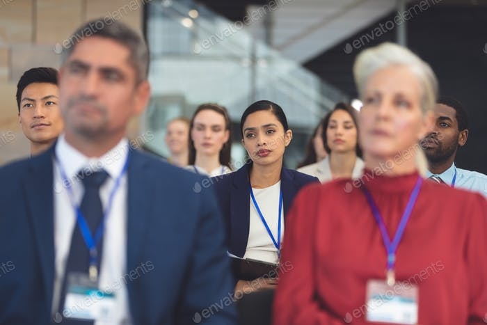 Front view of attentive mixed race young businesswoman in a business seminar in office