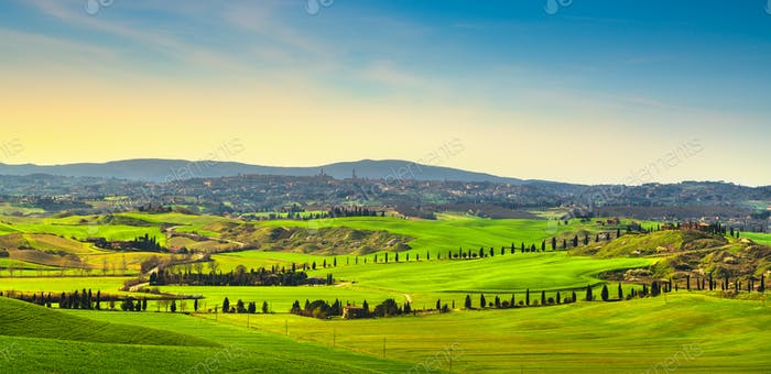 Siena city skyline, countryside and rolling hills. Tuscany, Ital