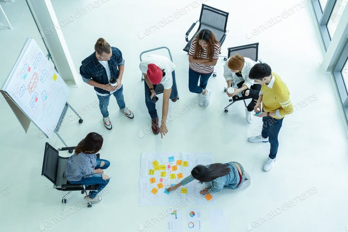 Top view Group Of Asian and diverse Business people with casual suit brainstorming and helping