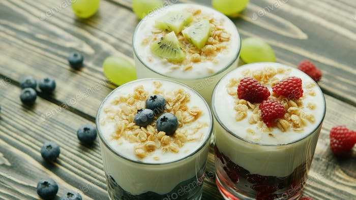Glasses with fruit and yogurt desserts