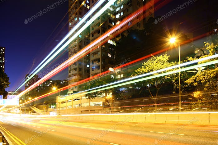 Busy traffic trail in city at night
