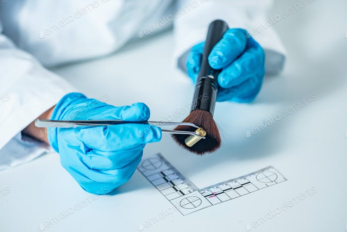Forensic scientist examining bullet casing