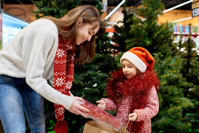 Young Family Buying Christmas Decorations