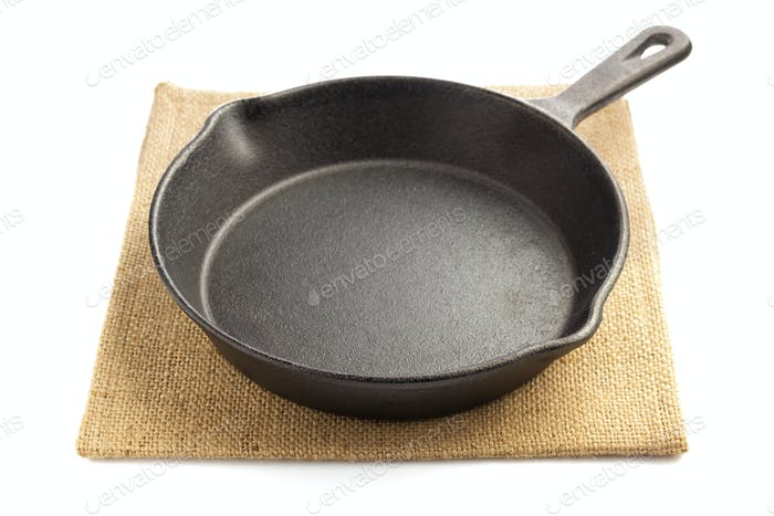 frying pan and napkin isolated on white
