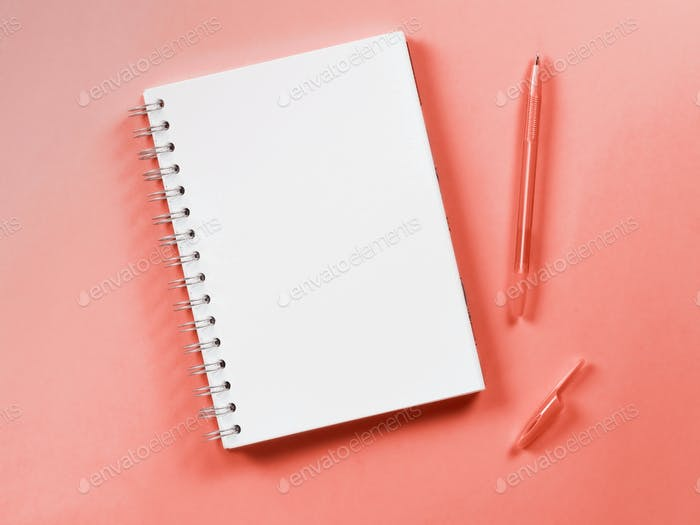Top view of blank note on living coral background