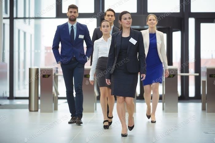 Businesspeople walking in a lobby