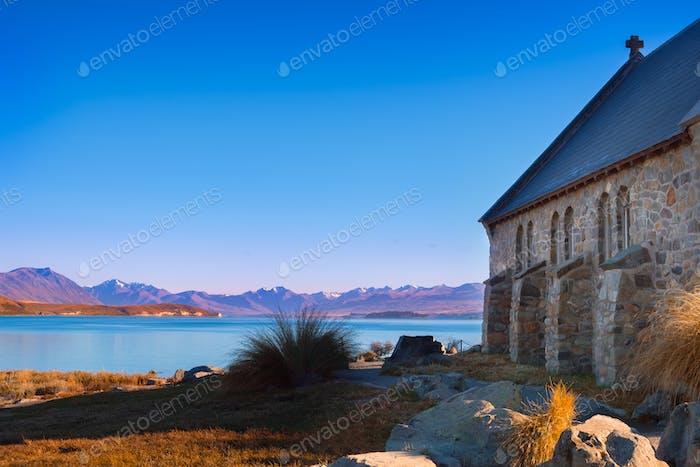 Colorful autumn view of Lake Tekapo with Church of good shepherd