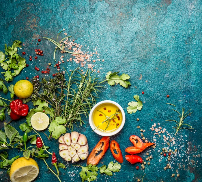 Fresh herbs and spices on blue turquoise background