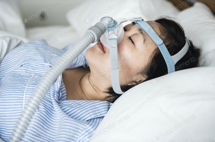 A woman wearing anti-snoring chin straps