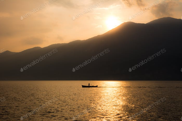 Boat silhouette at Lake Garda