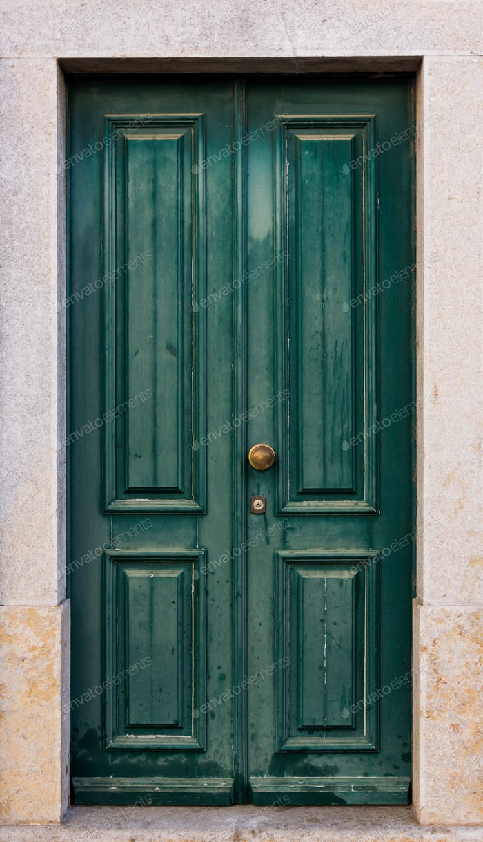 Green door. entrance door in front of residential house.