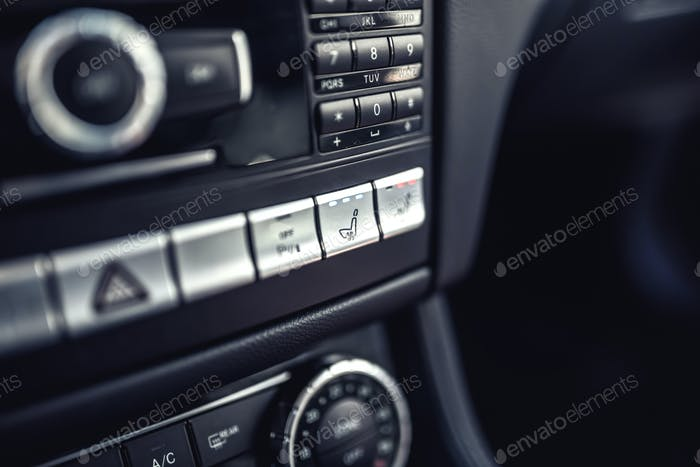 Modern car dashboard with seat ventilation and heating system. Modern details of electric car