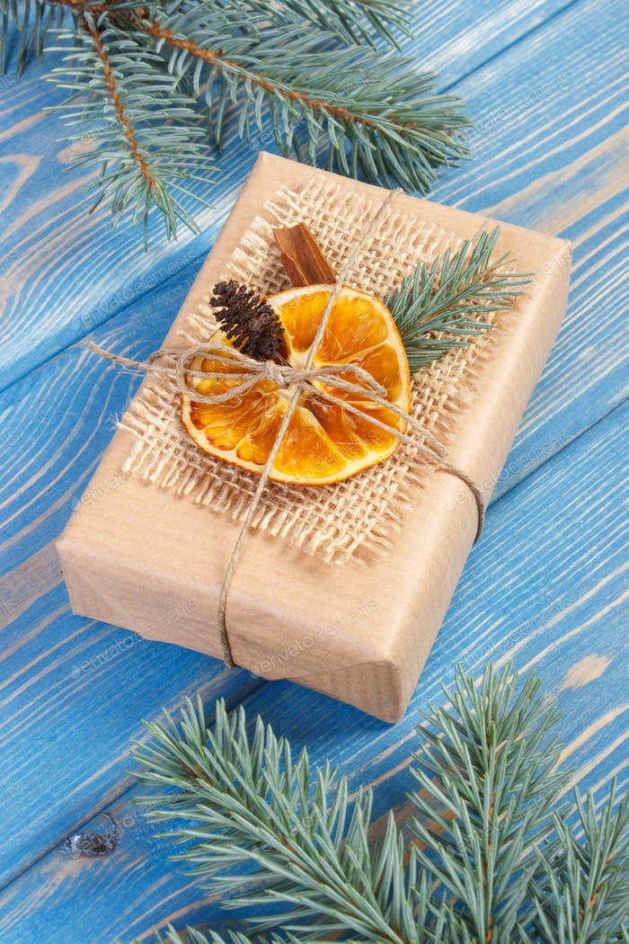 Wrapped gift with decoration for Christmas or other celebration