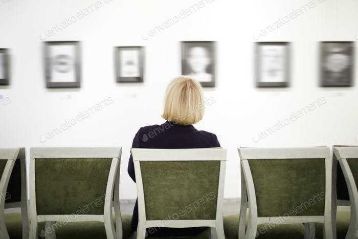 Unrecognizable Woman in Art Gallery
