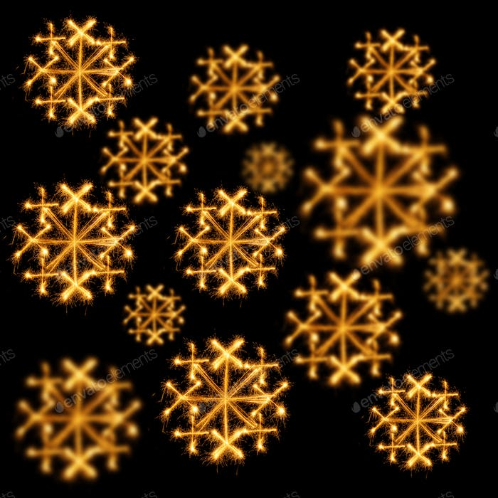 Background of snowflakes made  with sparklers on black