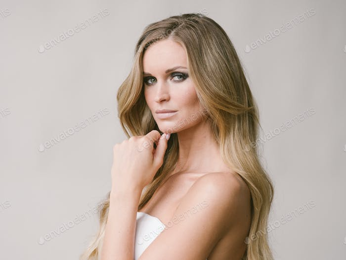 Beautiful woman long hair blonde natural portrait with beauty makeup