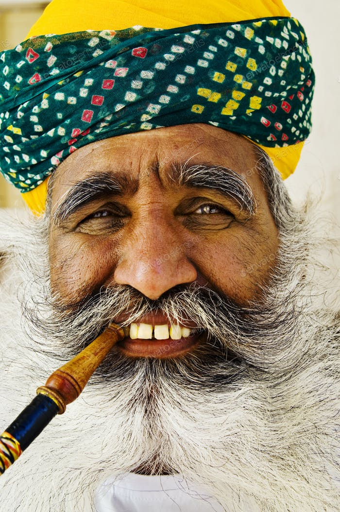 India Man Smoking a Pipe