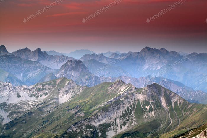 red sunrise over mountain peaks