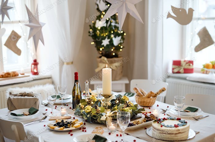A table set for dinner meal at Christmas time.