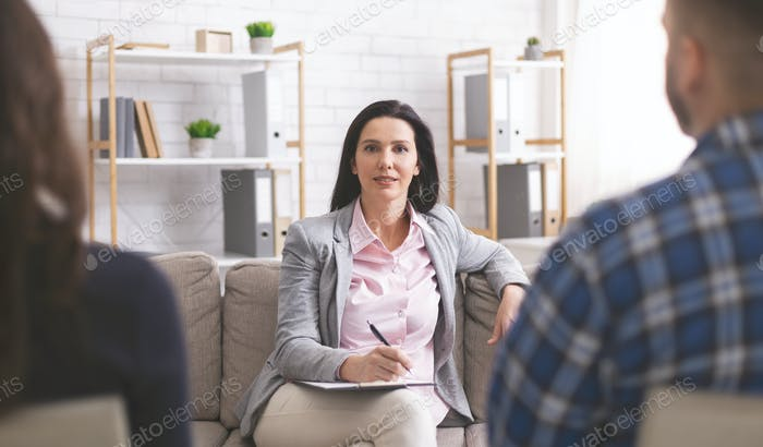 Confident psychologist working at marital therapy session