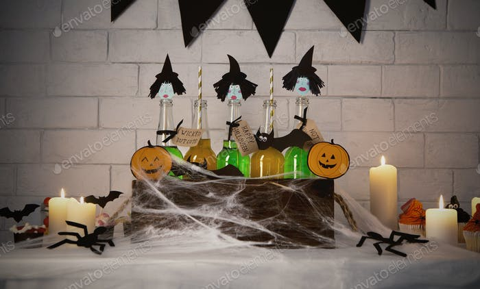 Cute witches with green bodies inside box with spider web