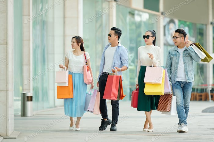 Young people shopping together