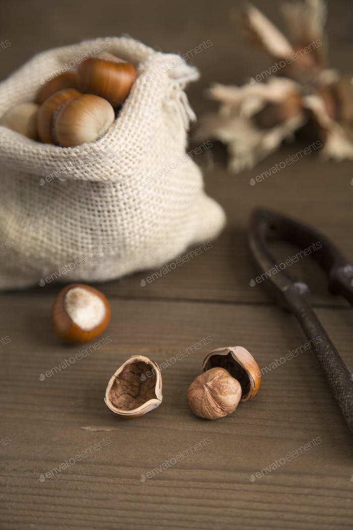 Rustic table with hazelnuts and nutcracker