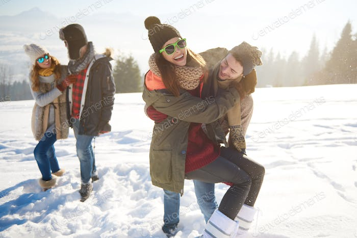 Cheerful travelers in snowy mountains
