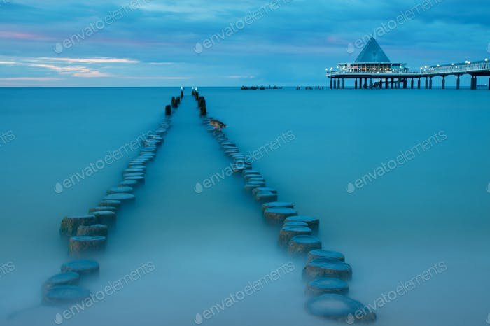 Old and new pier at dusk