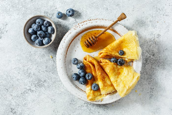 Crepes with honey and fresh blueberries
