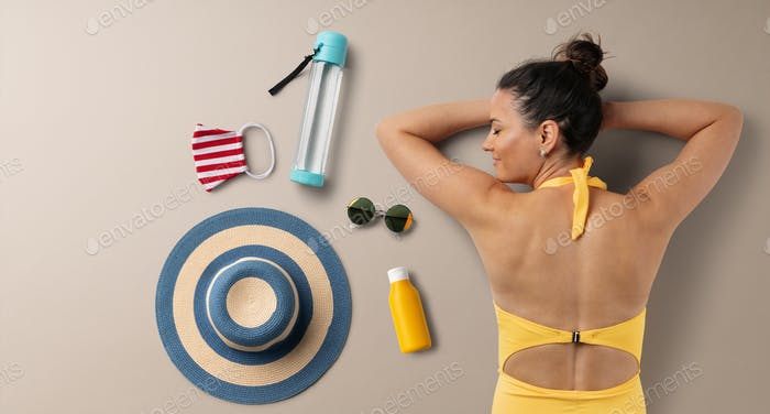Flat lay top view of young woman with travel essentials, summer holiday concept