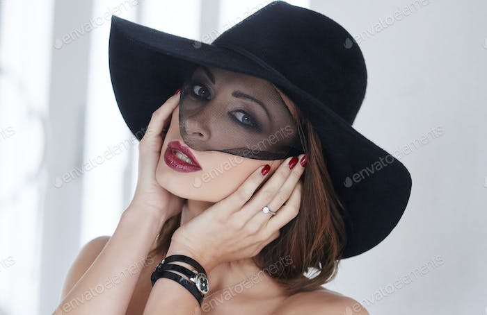 A woman in a black evening hat.