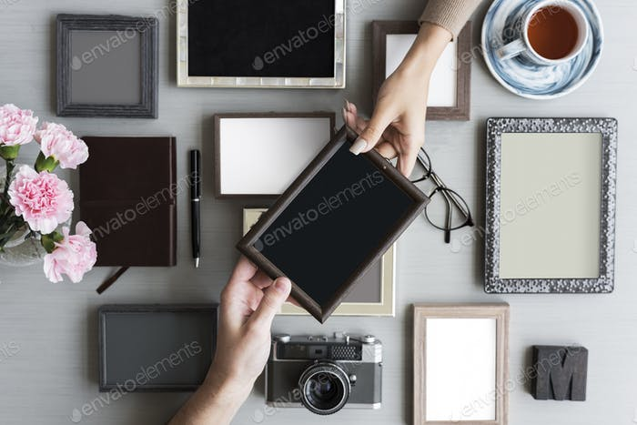 People Hands Getting Photo Frame on Gray Background