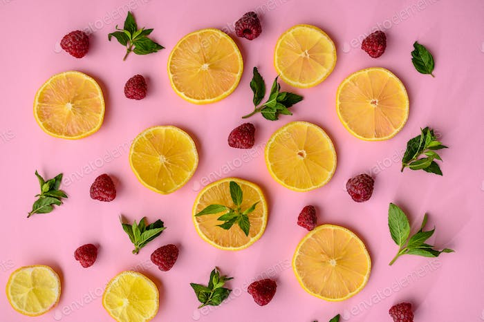 Lemon slices and strawberries on purple background