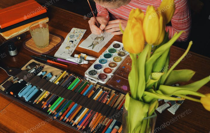 female artist painter painting a picture of a easter bunny