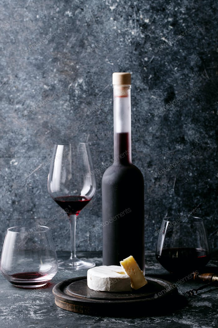 Glass of red wine served with cheese