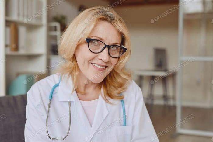 Smiling Female Doctor in Clinic