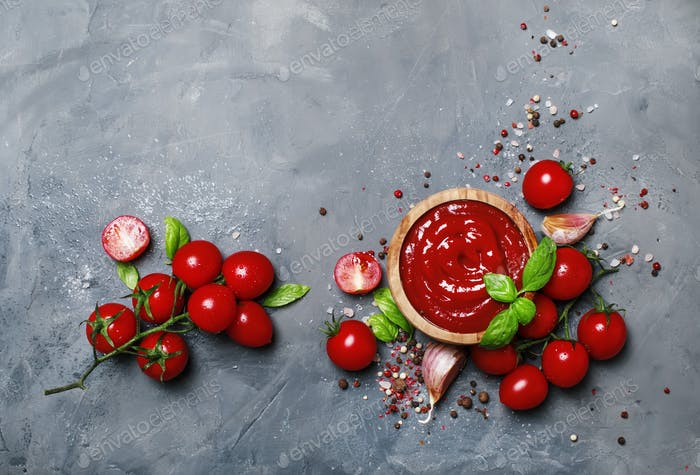 Tomato ketchup sauce with garlic, spices and herbs with cherry tomatoes