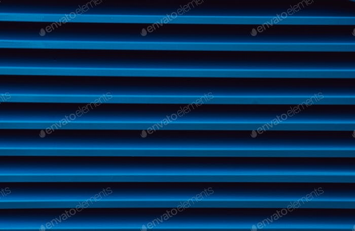 Close-up image of a blue metallic profile pattern. Metal ribbed surface.