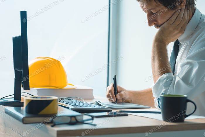 Interior design professional working on graphic tablet sketch pa