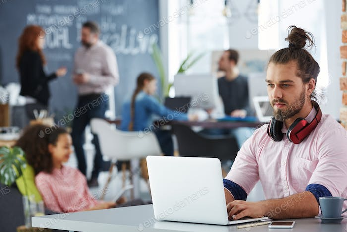 Confident man working on startup