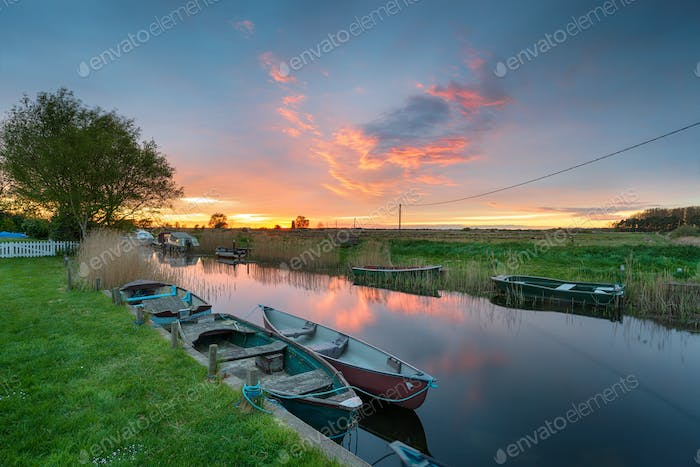 Stunning sunset over boats moored on the river at West Somerton