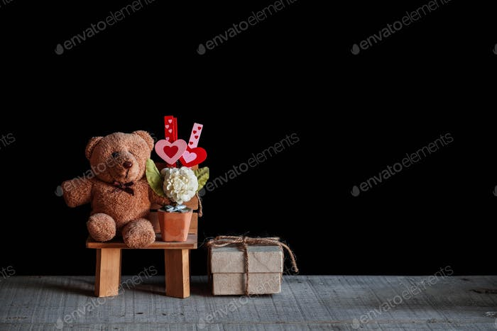 Teddy bears with love waiting on wooden floor