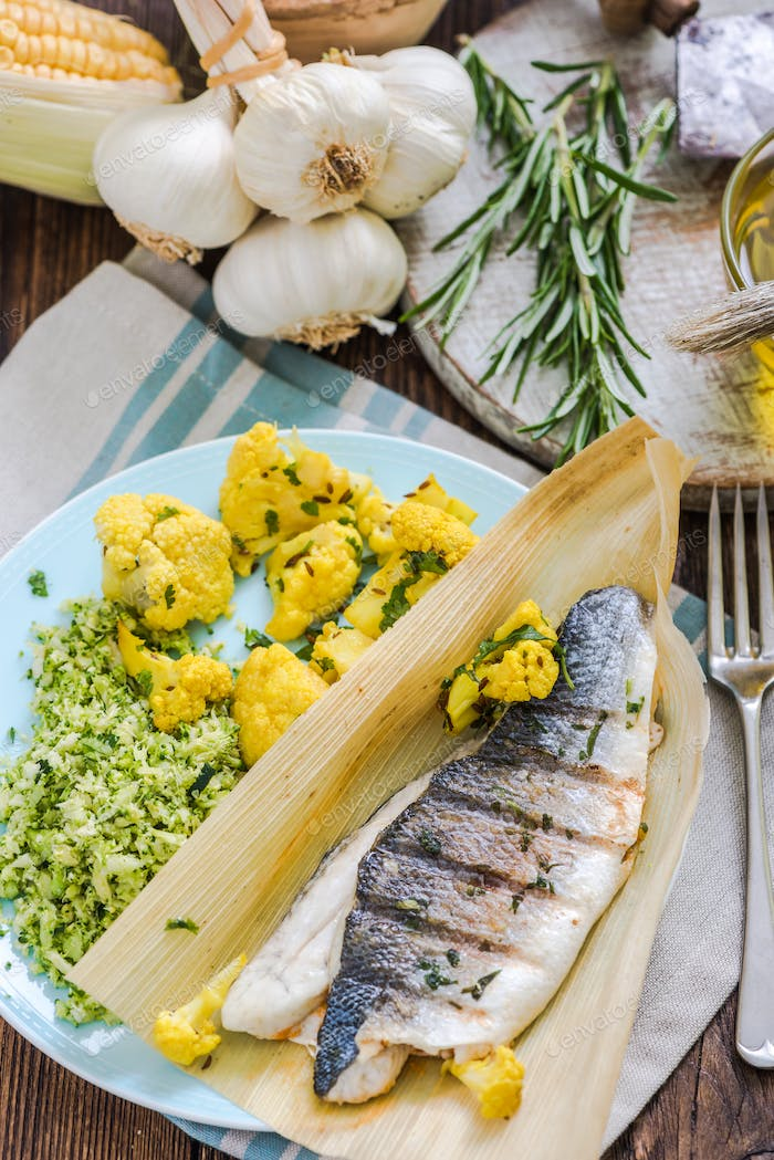 grilled seabass served with vegetable cous cous