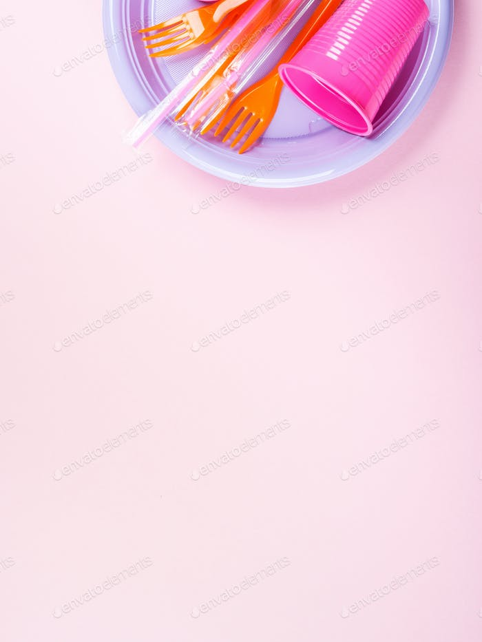 Disposable colorful plastic dish, straw and glass