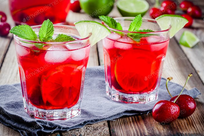 cherry lemonade with ice, lime and mint in glasses