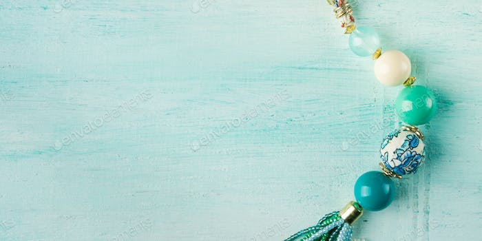 Girl's necklace on turquoise